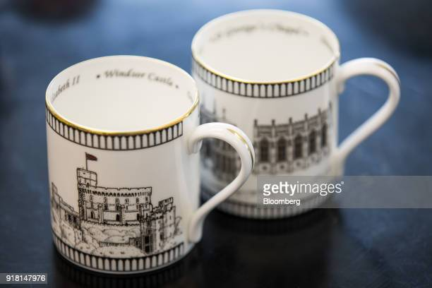 Two china mugs made to commemorate the wedding between Henry Windsor and Meghan Markle stand on display at Halcyon Days Ltd's factory in StokeonTrent...