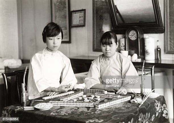 Two Chinese girls playing the old Chinese game of Mah Jongg