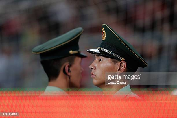 Two Chinese paramilitary police In the alert during the international friendly soccer match at Beijing Workers' Stadium on June 11 2013 in Beijing...