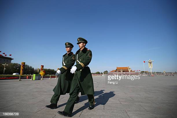 Two Chinese paramilitary police officers patrol on the Tiananmen Square after the closing session of the 18th National Congress of the Communist...