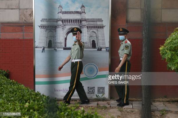 Two Chinese paramilitary police officers patrol outside the Indian embassy in Beijing on June 16 2020 China on June 16 accused India of crossing a...
