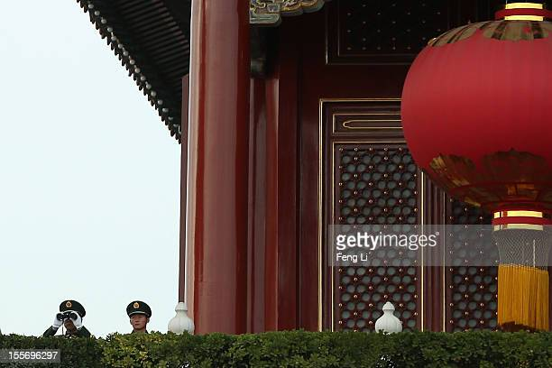 Two Chinese paramilitary policemen monitor the square with telescope on the Tiananmen Gate on November 7 2012 in Beijing China The18th National...