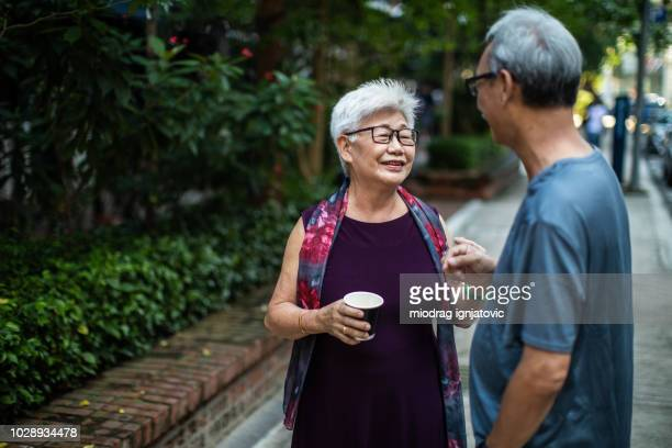 two chinese senior adults in the park - chinese culture stock pictures, royalty-free photos & images