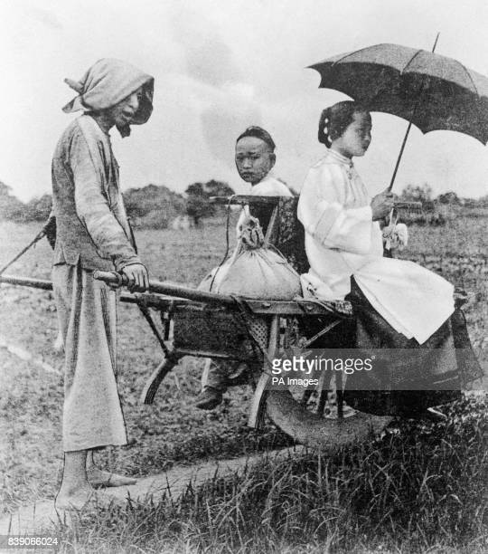 Two Chinese women on a Chinese wheelbarrow In October of 1911 the revolution started in China which would see the end of the Qing Dynasty