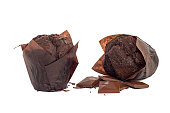 two chocolate muffins with chocolate pieces