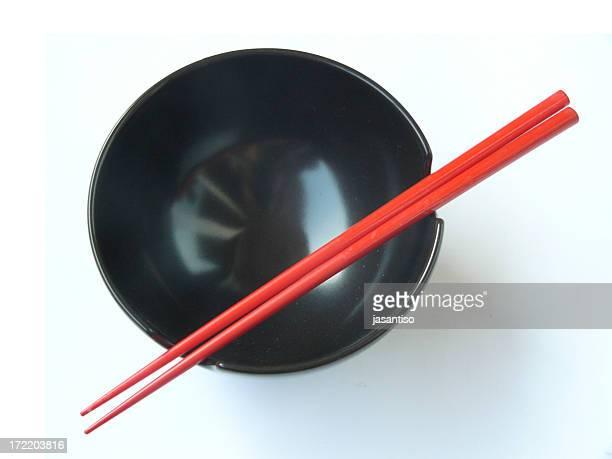 two chopsticks over a bowl