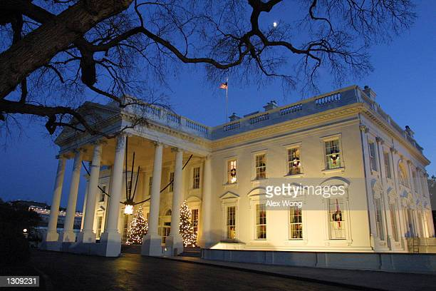 Two Christmas trees light up the North Portico of the White House December 4 2000 in Washington DC First Lady Hillary Rodham Clinton announced that...