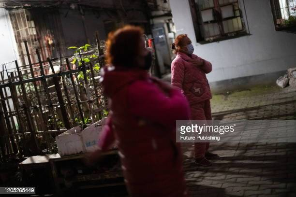 Two citizens exercise in the courtyard, Wuhan City, Hubei Province, China, March 4, 2020. - PHOTOGRAPH BY Costfoto / Barcroft Studios / Future...