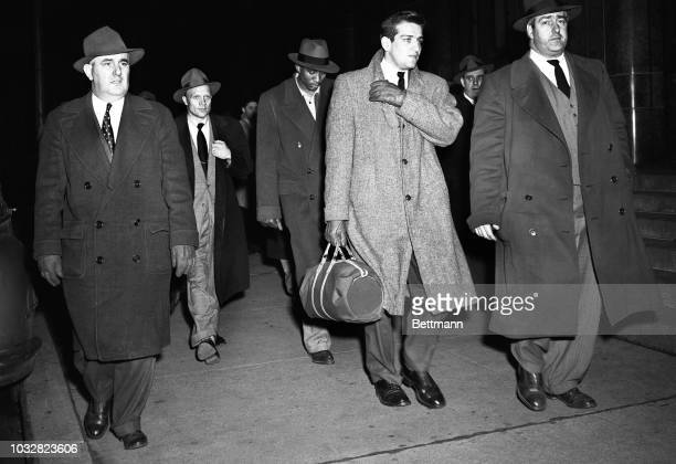 Two city college basketball stars, Al Roth and Ed Warner are escorted by detectives into the Elizabeth Street Station House for booking on charges of...