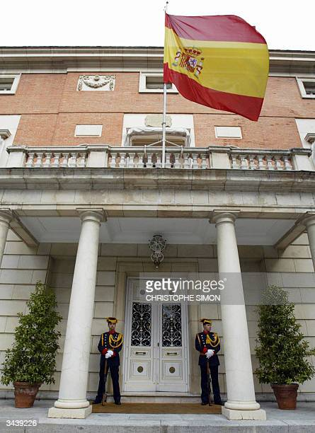 Two Civil Guards stand in front of the Moncloa Palace, where Jose Luis Rodriguez Zapatero just entered as the new Spanish prime minister, in Madrid...