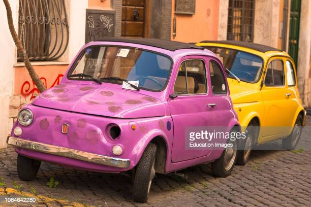 Two classic Fiat 500 cars parked on Trastevere backstreet, Rome, Lazio, Italy.