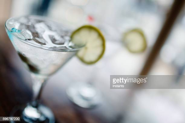 two classic martinis - dirty martini stock photos and pictures