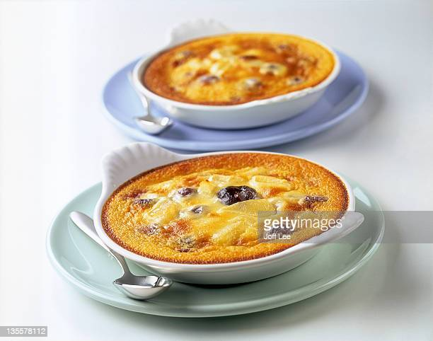 Two claufoutis flans in white bowls