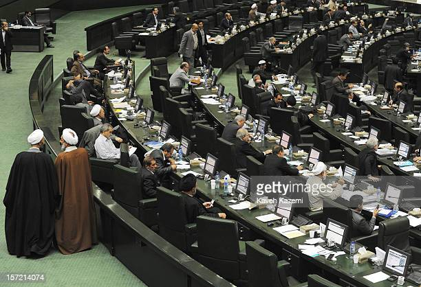 Two clergy MPs seen talking while they walk on the floor of Iranian parliament during an ongoing debate on November 6 2012 in Tehran Iran