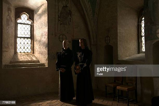 two clergymen in church - pastor stock pictures, royalty-free photos & images