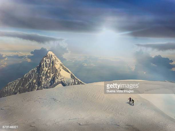 two climbers on a snowy slope