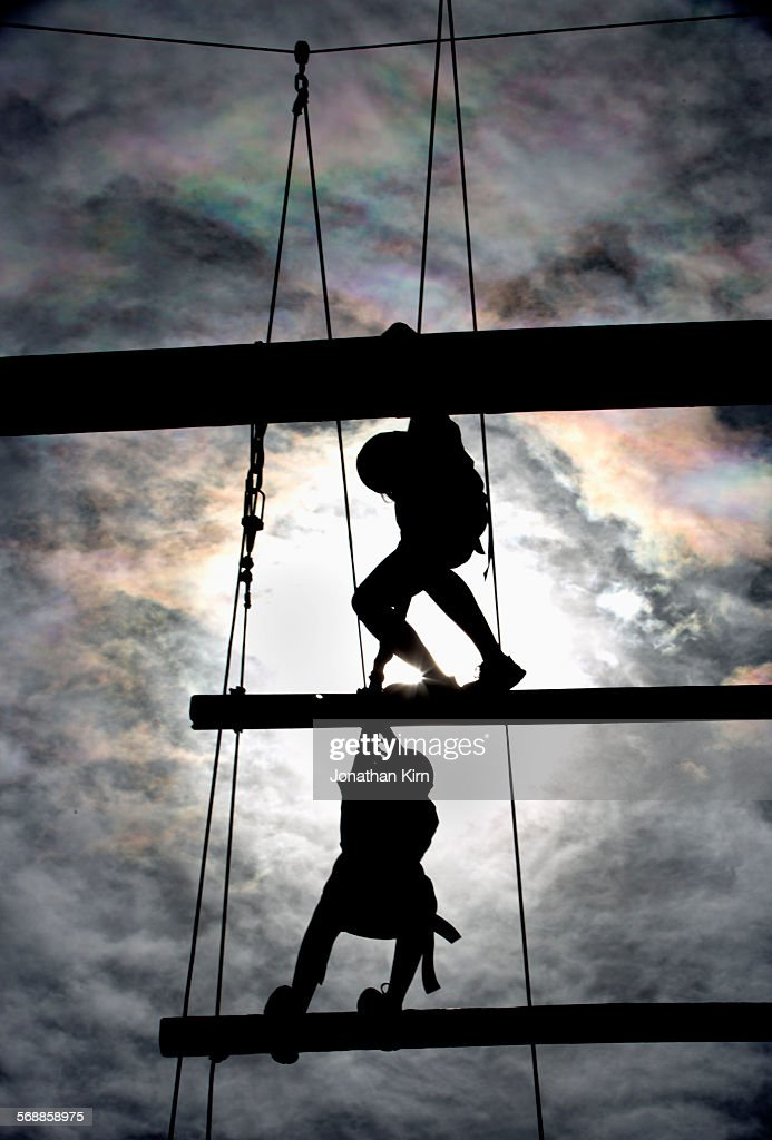 Two climbers on obstacle course : Stock Photo