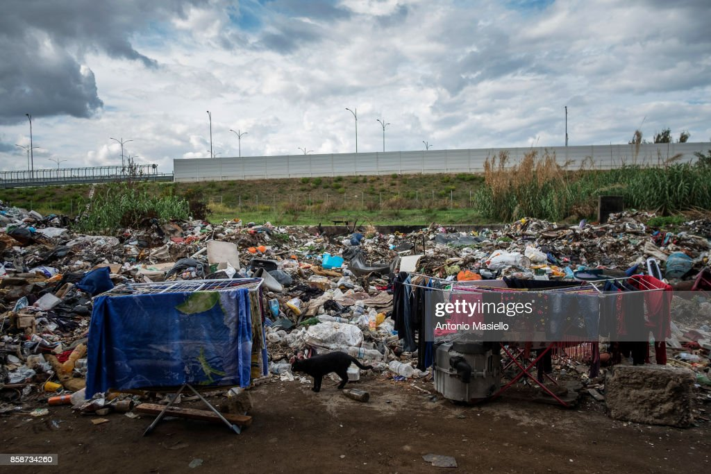 Two clotheshorses stand next to a pile of refuse outside an occupied building on October 4, 2017 in Rome, Italy. For the last 5 years, hundreds of people, including Italians, Roma and refugees, including around 35 children, have lived in an occupied building on the suburbs of Rome without electricity or a toilet and surrounded by refuse.