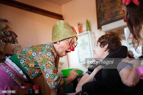 Two clowns from the H™piclowns association perform in a home for disabled adults in Geneva Switzerland