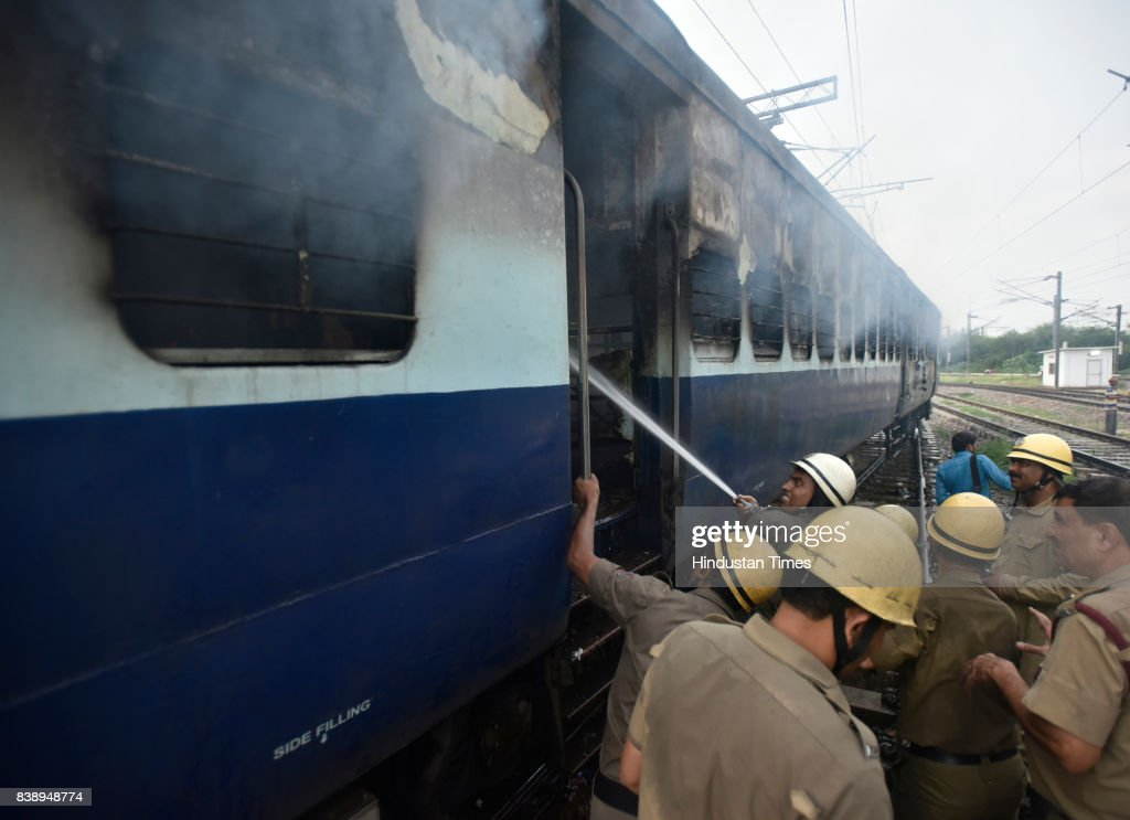 Two coaches of empty Rewa Express set on fire near Anand Vihar railway station on August 25 2017 in New Delhi India Gurmeet Ram Rahim the selfstyled..
