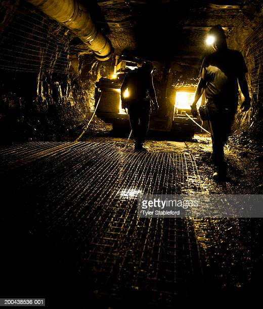 two coal miners in mine shaft (yellow tone) - coal mine stock pictures, royalty-free photos & images