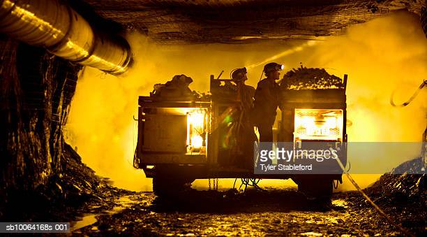 two coal miners in mine shaft - coal mining stock photos and pictures