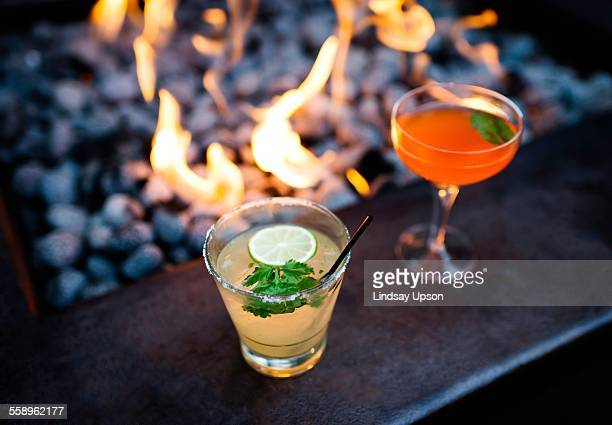 Two cocktails by restaurant open fire