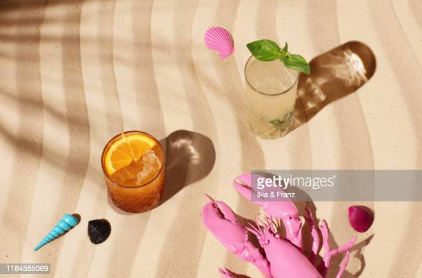 two cocktails on a beach - animal body part stock pictures, royalty-free photos & images