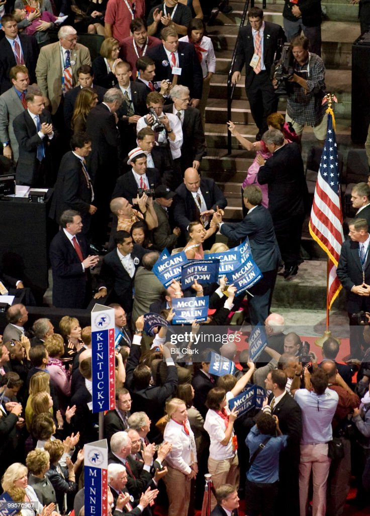 Two Codepinkk portesters are pulled off the floor of the Republican National Convention during vice preseidential candidate Sarah Palin's speech at the Xcel Center in St. Paul, Minn., on Wednesday, Sept. 3, 2008.