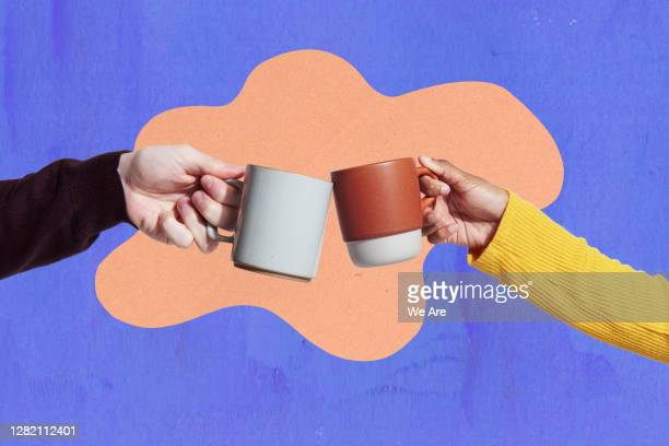 two coffee mugs touching - cup stock pictures, royalty-free photos & images