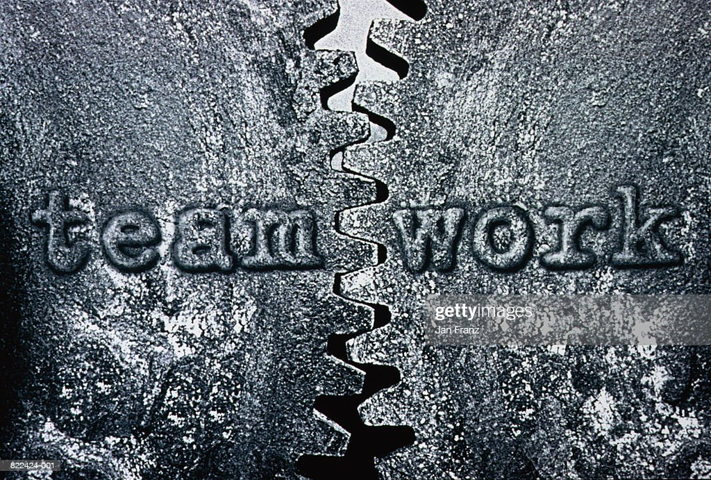 Two cogs, 'teamwork' written on surface, (B&W, Digital Composite) : Stock Photo
