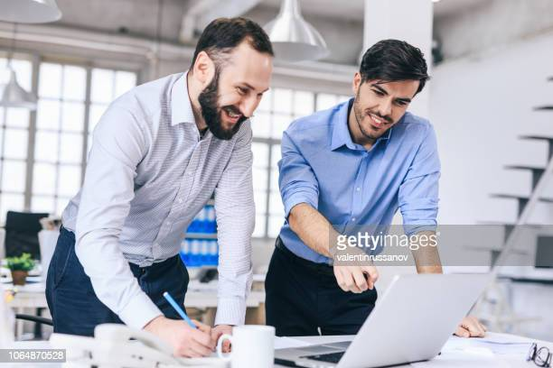 two colleague discussing new project - sales occupation stock pictures, royalty-free photos & images