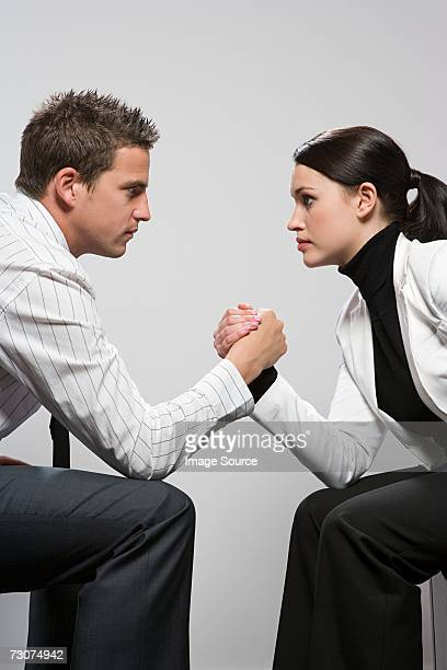 Two colleagues arm wrestling