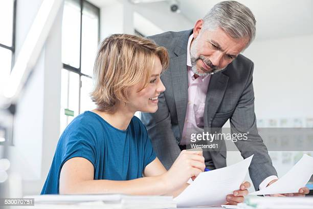 Two colleagues discussing something in an office