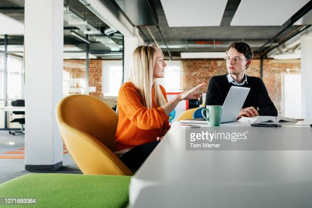 two colleagues discussing technical problem at desk - business casual stock pictures, royalty-free photos & images