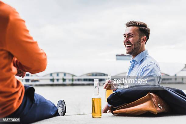 two colleagues having a beer after work - after work stock photos and pictures