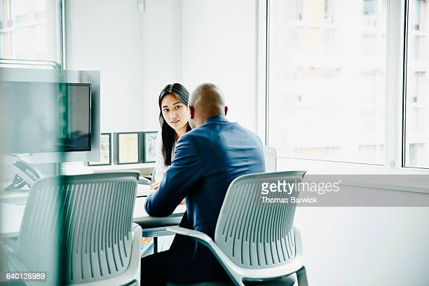 two colleagues in meeting in office - doing a favor stock pictures, royalty-free photos & images