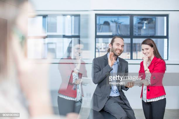 two colleagues in office talking about someone else - gossip stock pictures, royalty-free photos & images