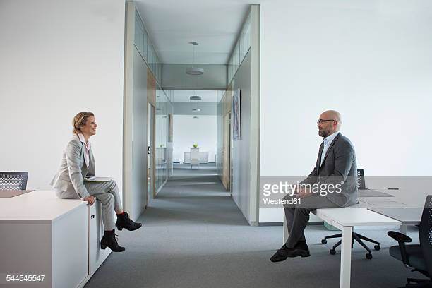 Two colleagues sitting on office floor