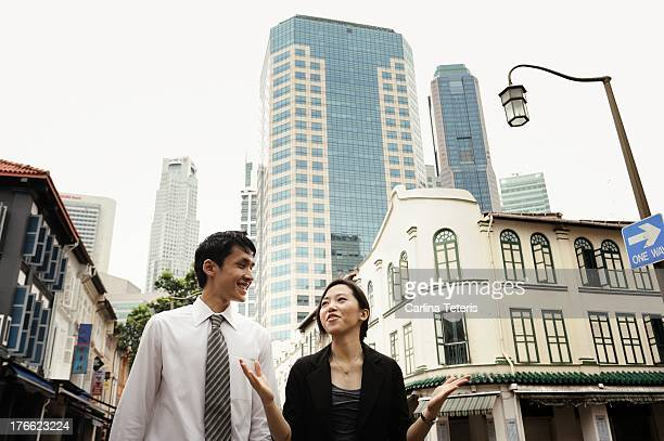 Two colleagues talking downtown Singapore