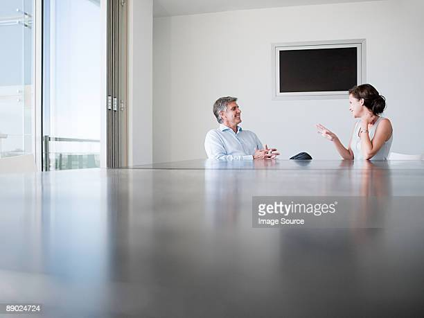 Two colleagues talking in a conference room