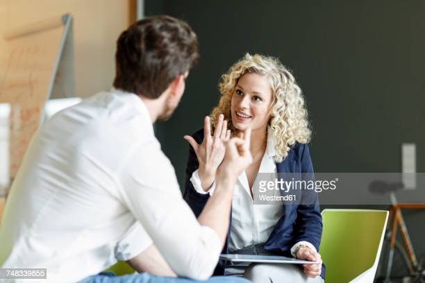 Two colleagues talking in office