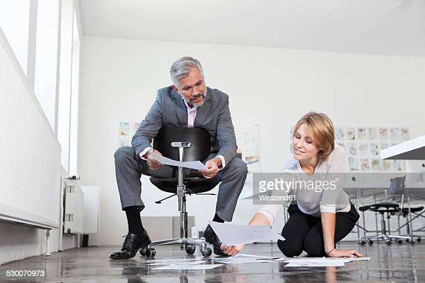 Two colleagues watching concepts in an office