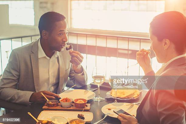 two collegaues having business lunch