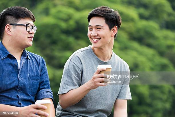 two college friends having a coffee break - chubby boy stock photos and pictures