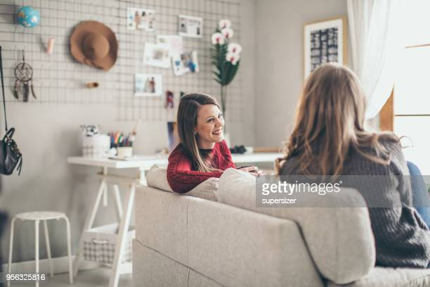 two college girls relaxing - roommate stock pictures, royalty-free photos & images