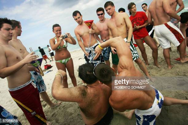 Two college students from the University of Wisconsin and the University of New Hampshire pose for a photo 14 March 2006 on South Miami Beach Every...