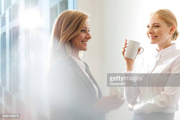 Two collegues having a coffee together