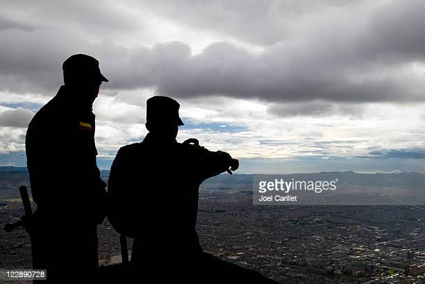 Security personnel looking down on Bogota, Colombia