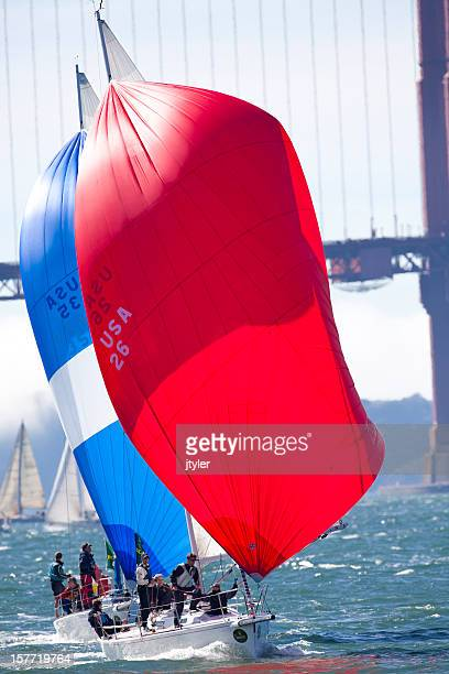Two Colorful Sailboats in a Close Race